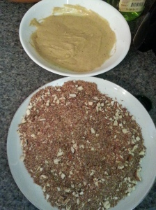 Dip chicken in mustard mixture, then into the almond-.flaxseed meal